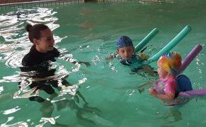 Swimming School Instructor and Two Kids Aqua Dynamics
